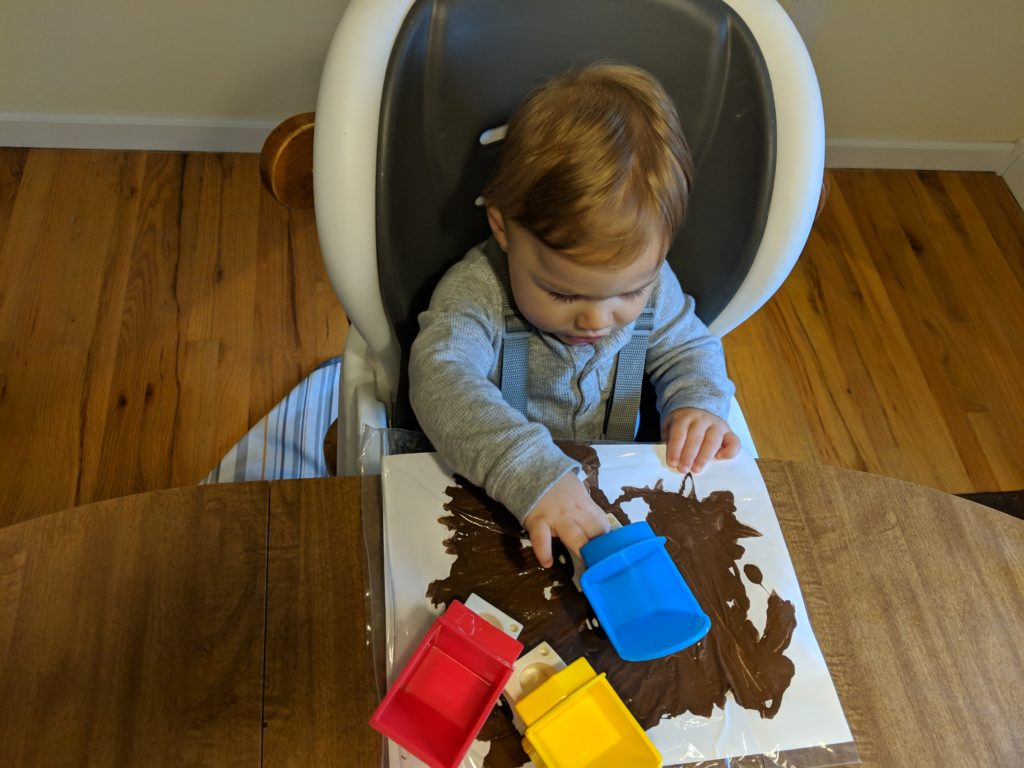 Little man painting with trucks.
