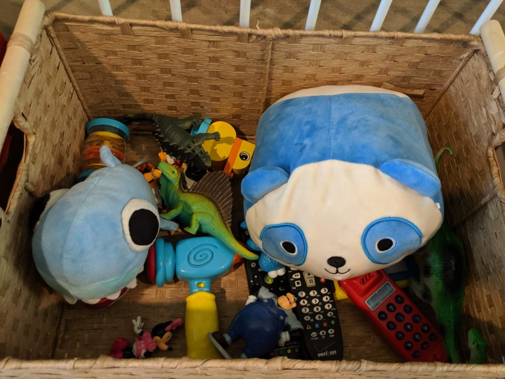 A basket of toys that are always available during my toy rotation system.