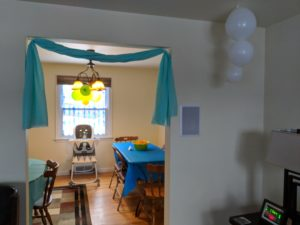 The door and balloon decorations for Little Man's baby shark party!