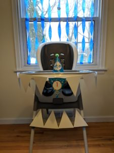 The high chair decorations for Little Man's baby shark party!