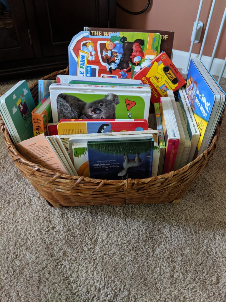 A basket of books that are always available during my toy rotation system.