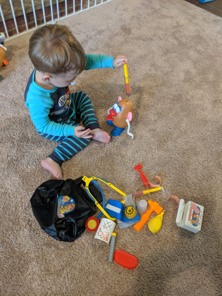 Little Man playing with his Doctor's Kit.