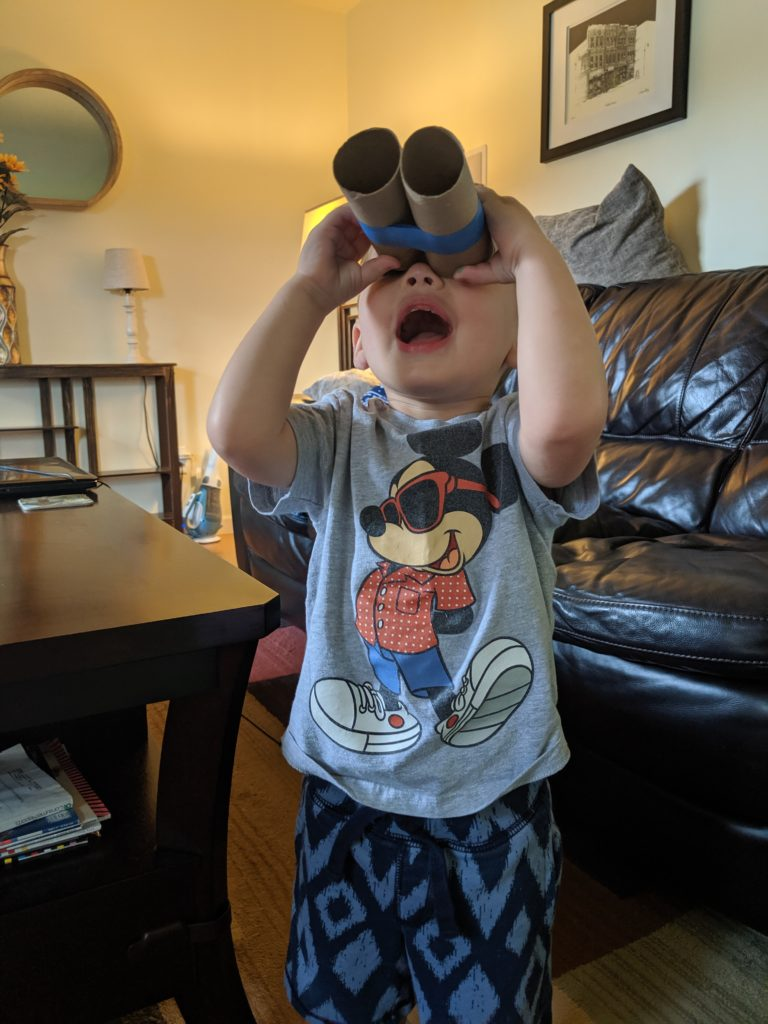 Little Man looking through his binoculars