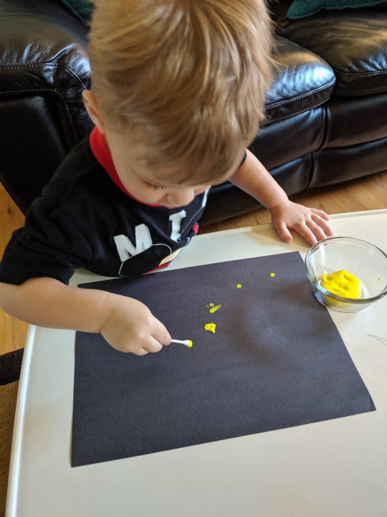 Little Man painting stars