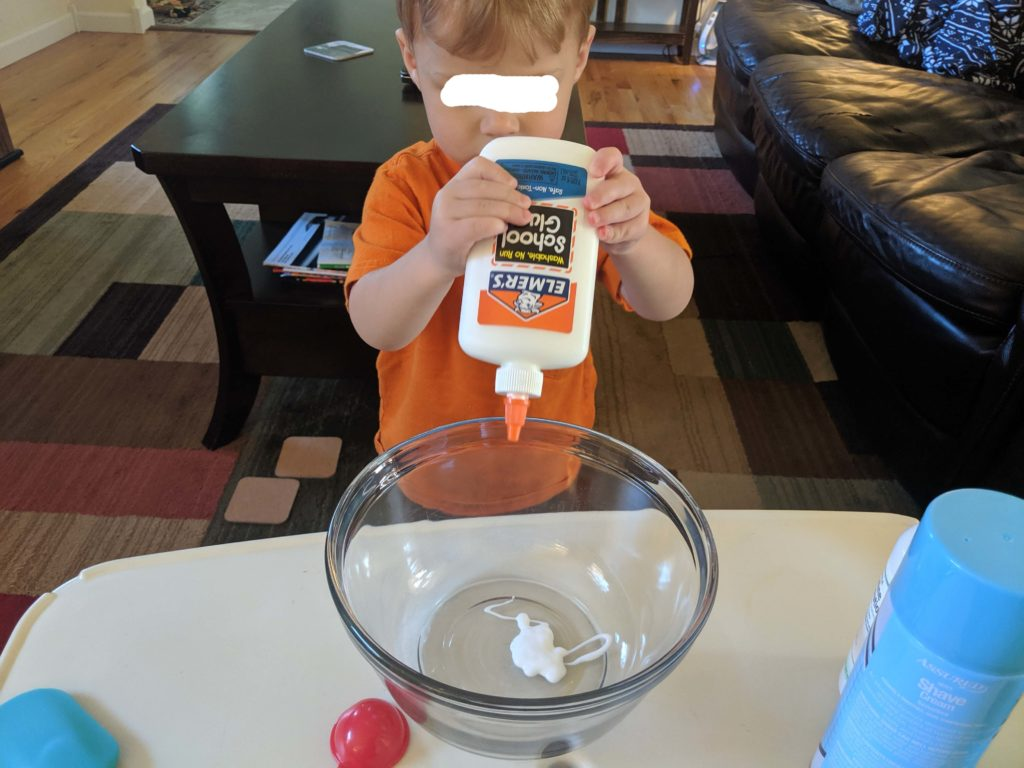 Little Man squirting the glue into the bowl.