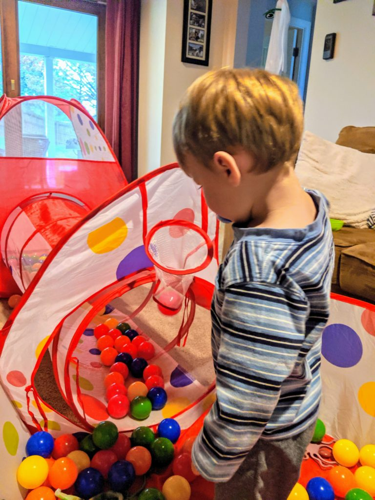 Little Man playing in his ball pit.