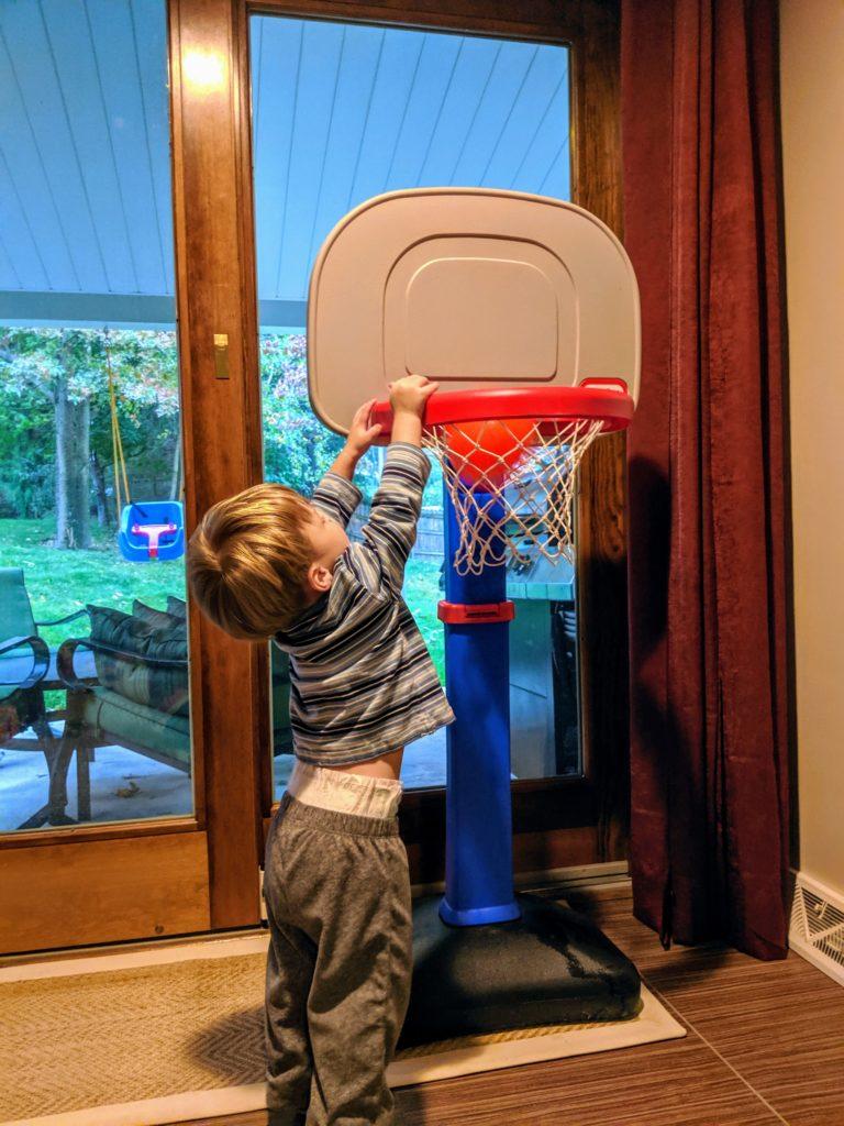 Little Man shooting hoops