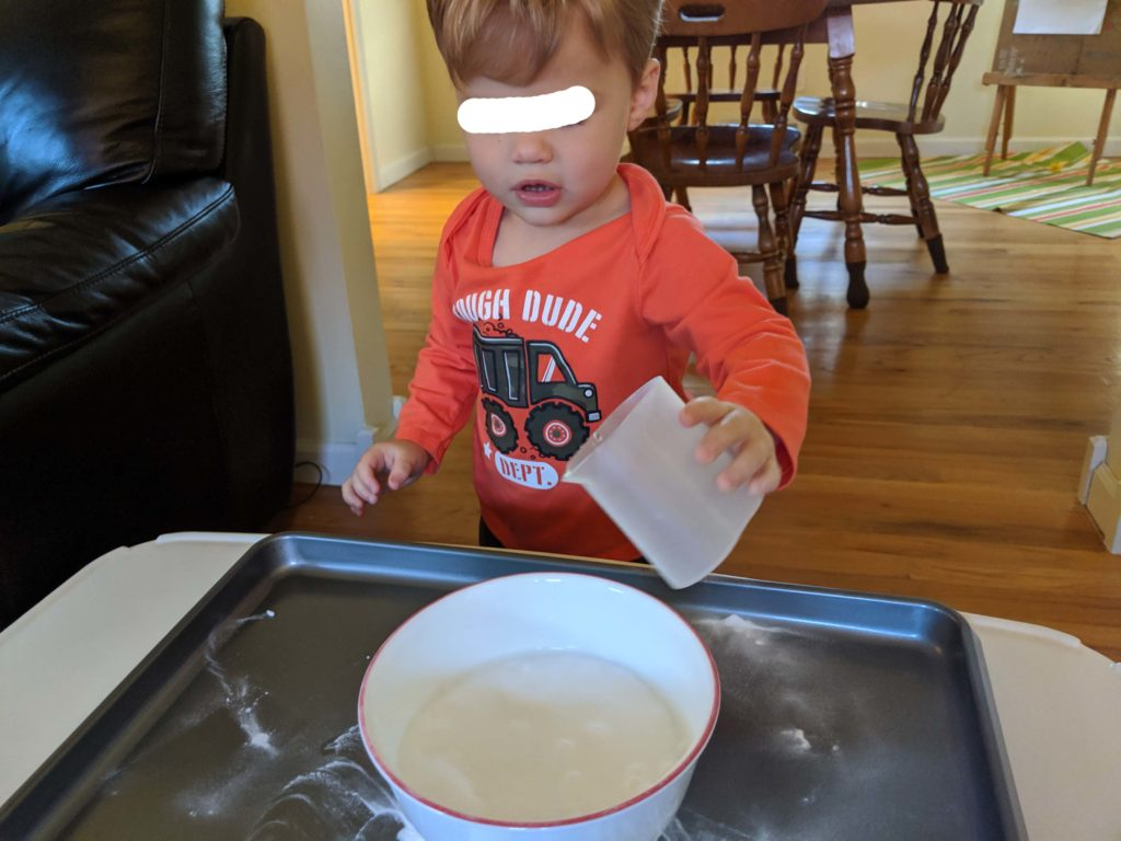 Little Man pouring the vinegar