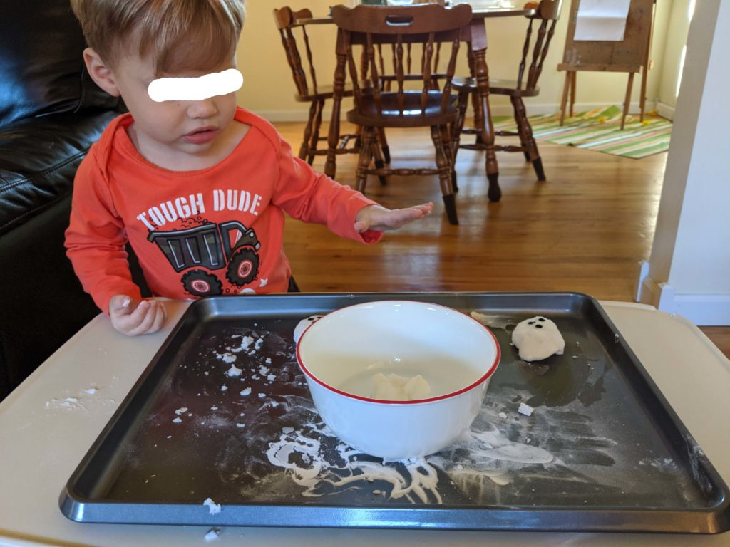 Little Man dropping the ghost into the vinegar