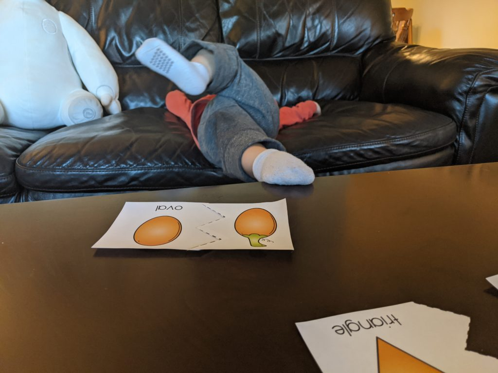 Little Man so over the Fall shape puzzle!